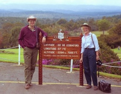 Photo from June, 1994 of Harry Doenlen and Liz Doenlen on their honeymoon in Kenya. There are standing next to a sign showing it is the  Equator.